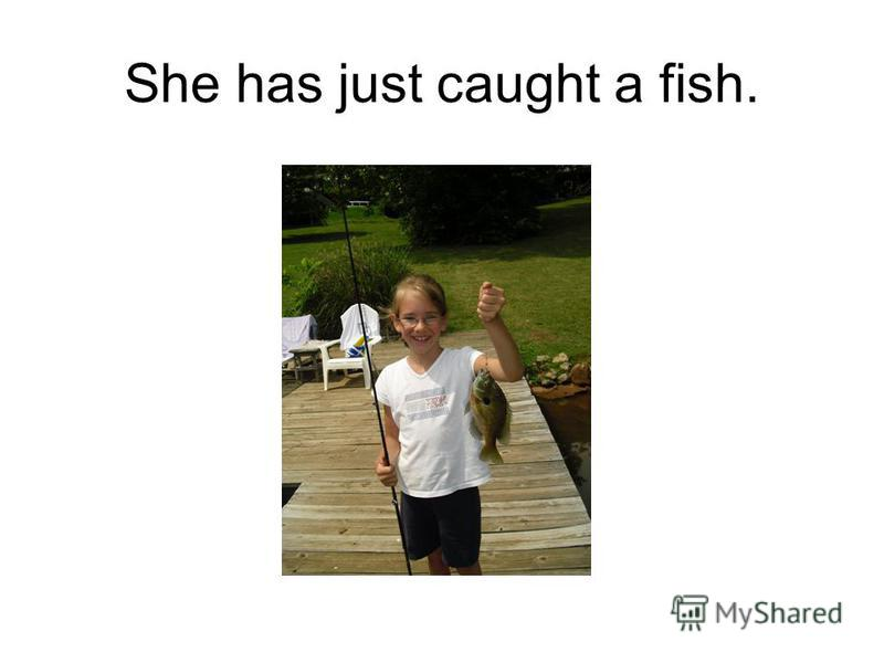 She has just caught a fish.