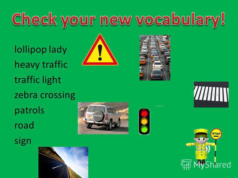 lollipop lady heavy traffic traffic light zebra crossing patrols road sign