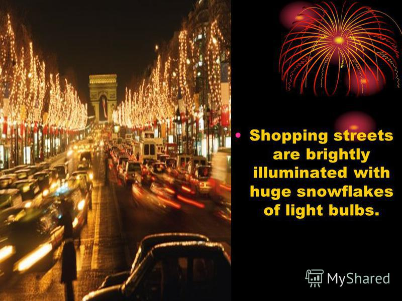 Shopping streets are brightly illuminated with huge snowflakes of light bulbs.