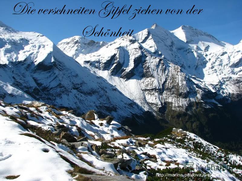 Die verschneiten Gipfel ziehen von der Schönheit