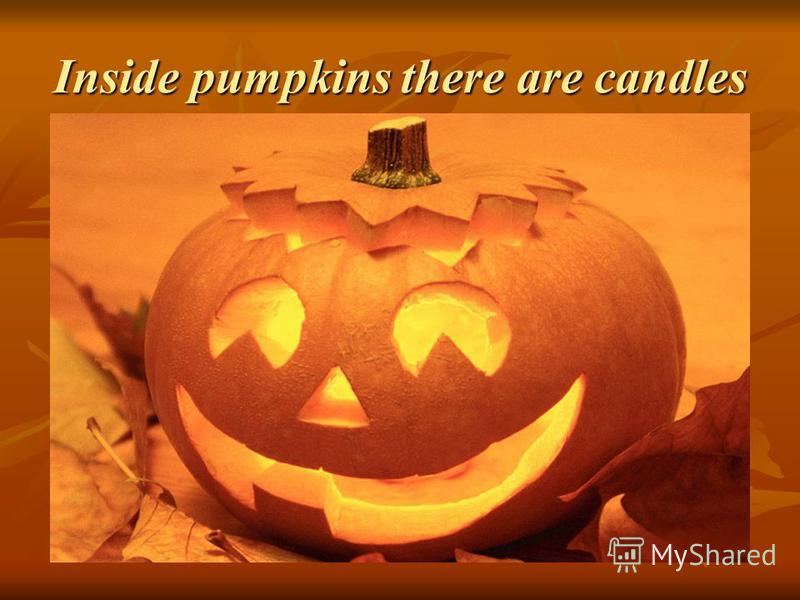 Inside pumpkins there are candles