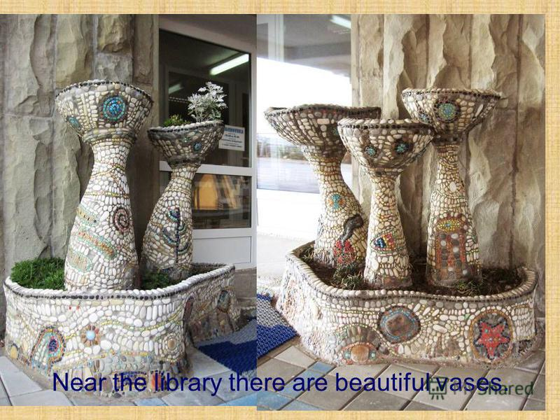 Near the library there are beautiful vases.