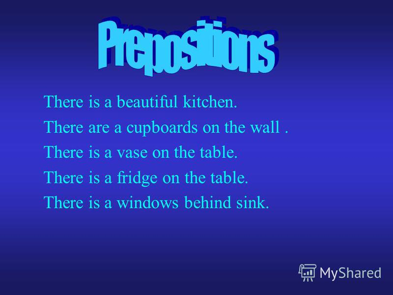 There is a beautiful kitchen. There are a cupboards on the wall. There is a vase on the table. There is a fridge on the table. There is a windows behind sink.
