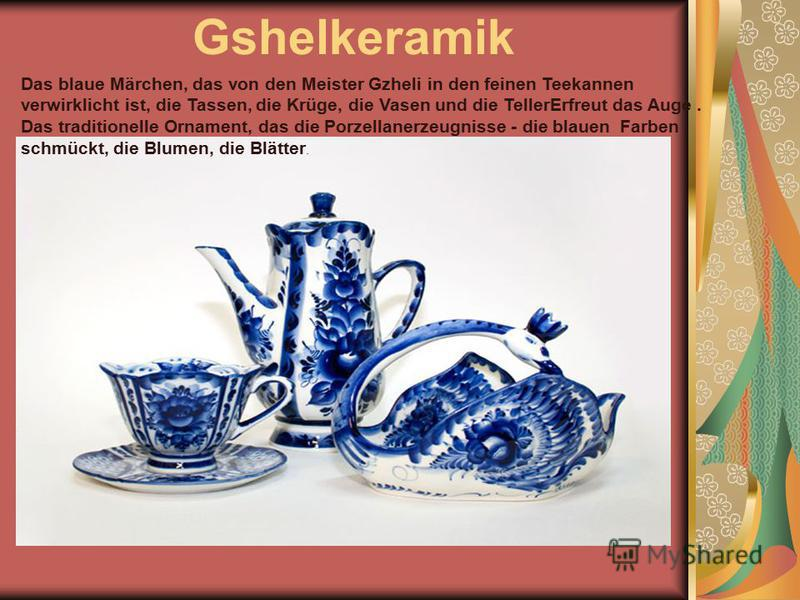 Gshelkeramik Das blaue Märchen, das von den Meister Gzheli in den feinen Teekannen verwirklicht ist, die Tassen, die Krüge, die Vasen und die TellerErfreut das Auge. Das traditionelle Ornament, das die Porzellanerzeugnisse - die blauen Farben schmück