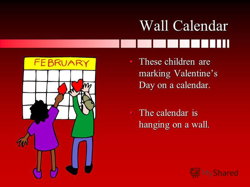 Wall Calendar These children are marking Valentines Day on a calendar. The calendar is hanging on a wall.