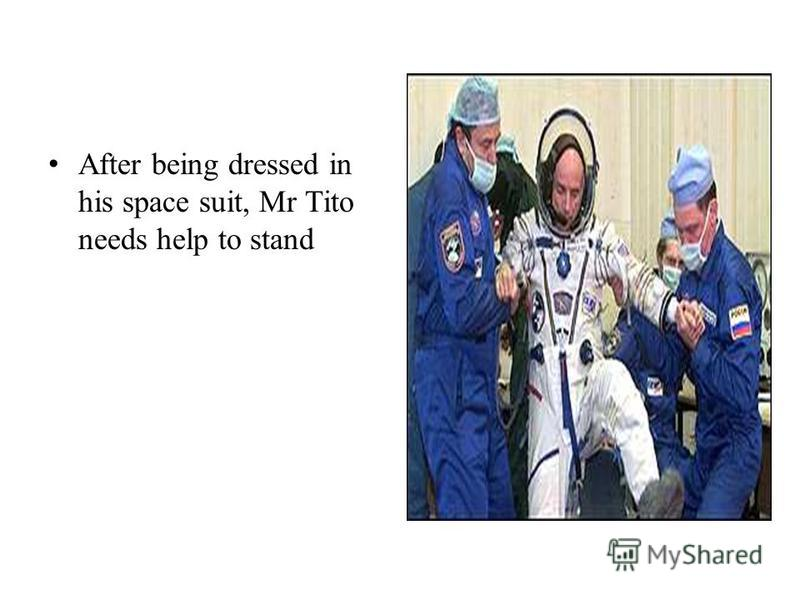 After being dressed in his space suit, Mr Tito needs help to stand