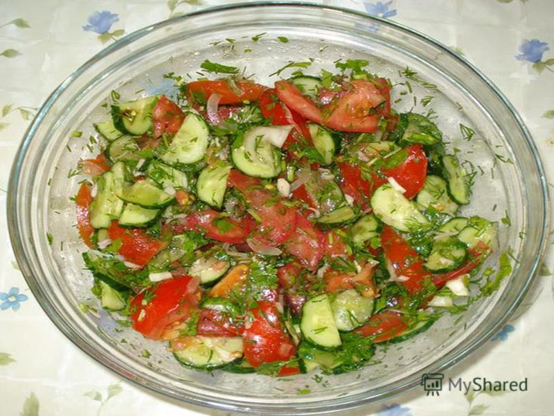 5.Put the chopped cucumbers and tomatoes into a bowls. 6.Add some salt. 7.Add the oil. Mix the cucumbers, tomatoes, spring onions and oil together.