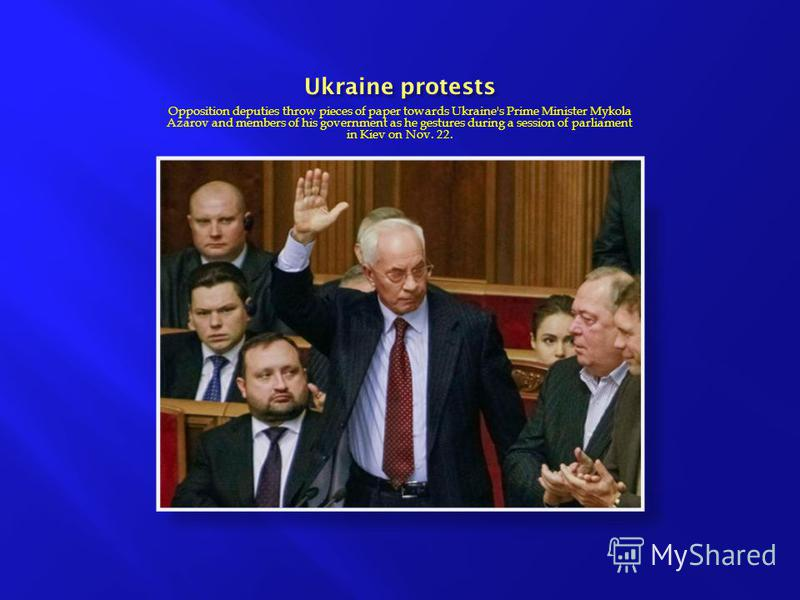 Opposition deputies throw pieces of paper towards Ukraine's Prime Minister Mykola Azarov and members of his government as he gestures during a session of parliament in Kiev on Nov. 22.