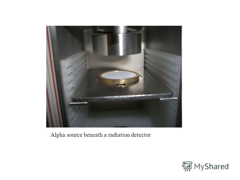 Alpha source beneath a radiation detector