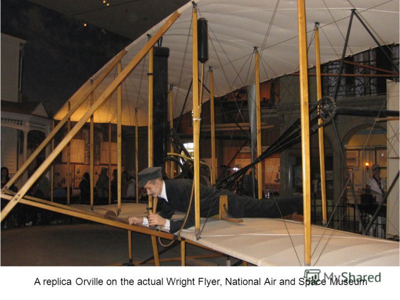 A replica Orville on the actual Wright Flyer, National Air and Space Museum