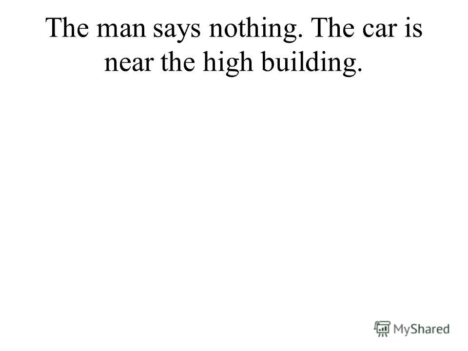 The man says nothing. The car is near the high building.