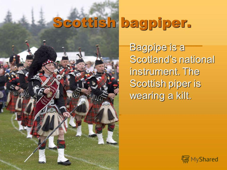 Scottish bagpiper. Scottish bagpiper. Bagpipe is a Scotlands national instrument. The Scottish piper is wearing a kilt. Bagpipe is a Scotlands national instrument. The Scottish piper is wearing a kilt.