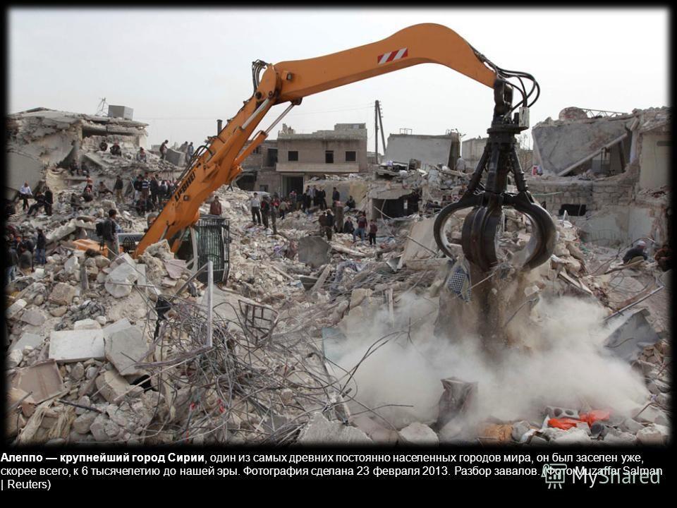 Пожарные пытаются спасти очередное горящее здание. Город Алеппо, 8 февраля 2013. (Фото Malek AlShemali | Reuters)