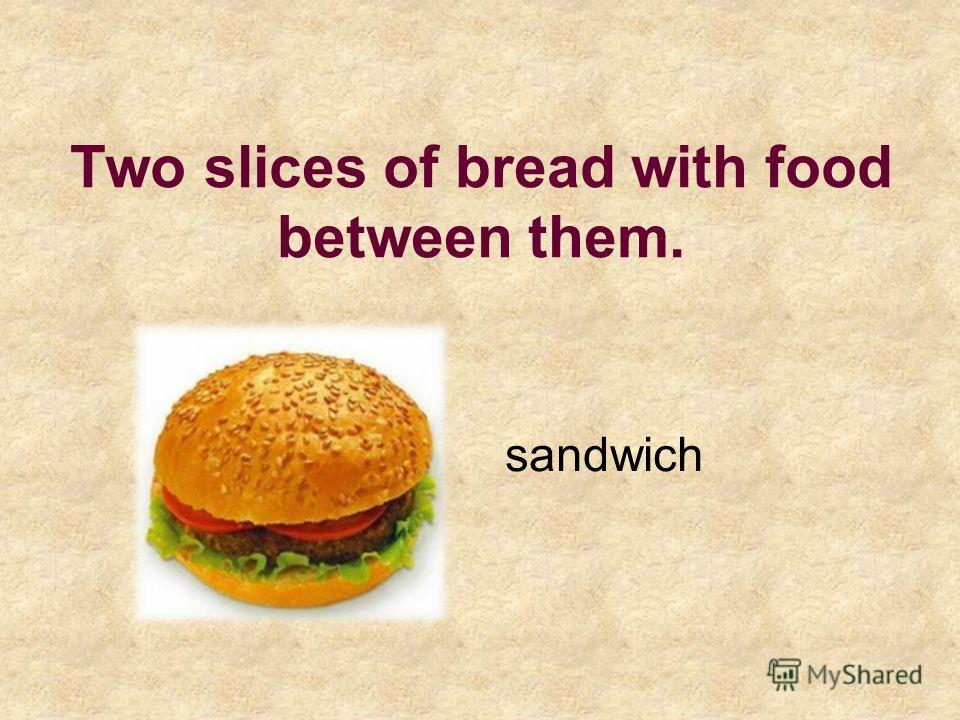 Two slices of bread with food between them. sandwich