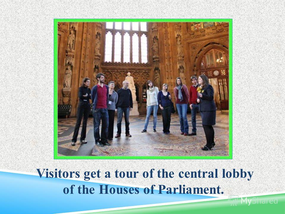 Visitors get a tour of the central lobby of the Houses of Parliament.