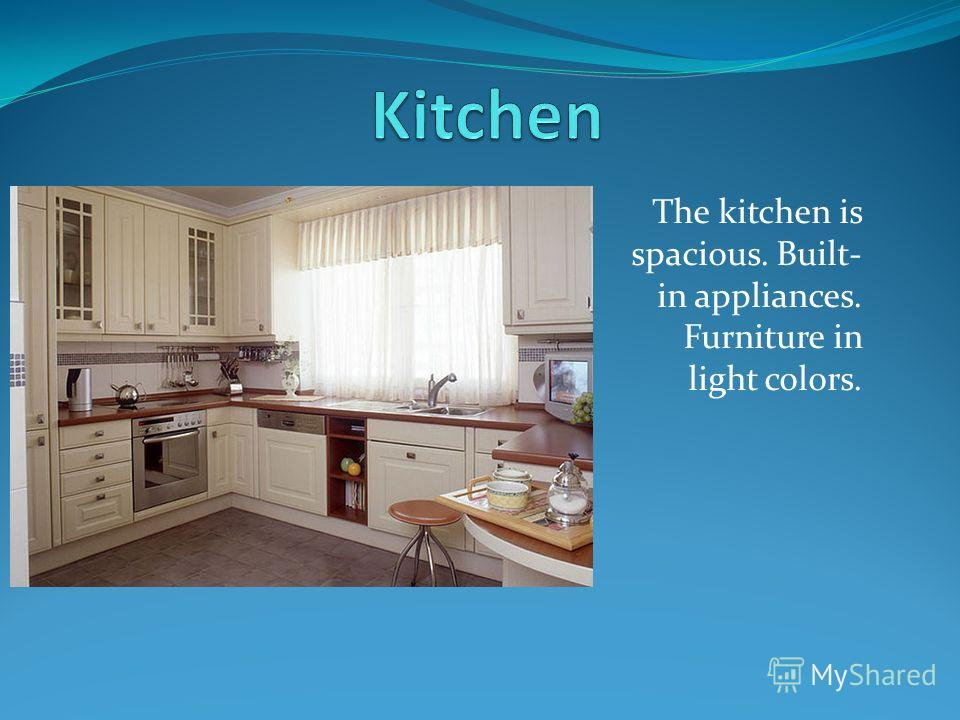 The kitchen is spacious. Built- in appliances. Furniture in light colors.