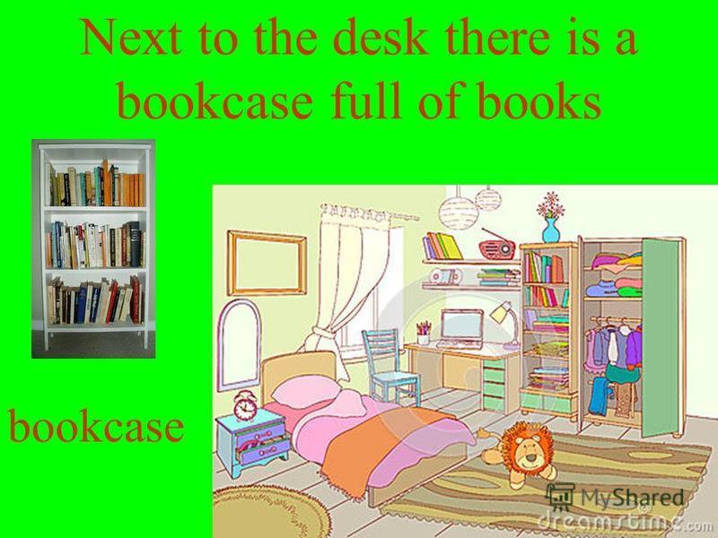 Next to the desk there is a bookcase full of books bookcase
