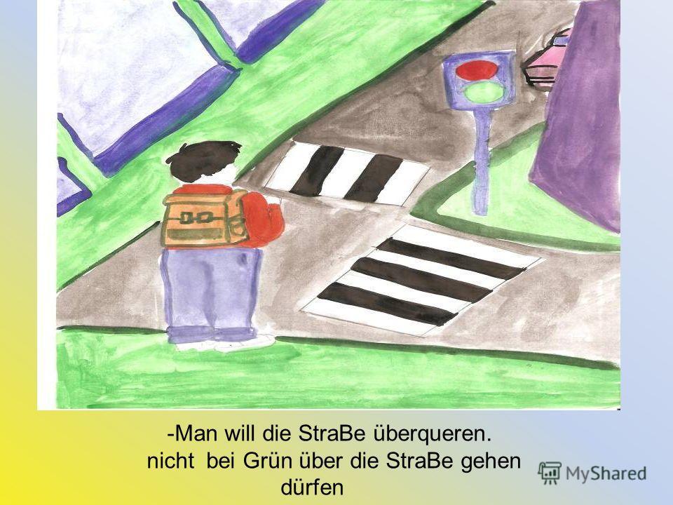 -Man will die StraBe überqueren. nicht bei Grün über die StraBe gehen dürfen