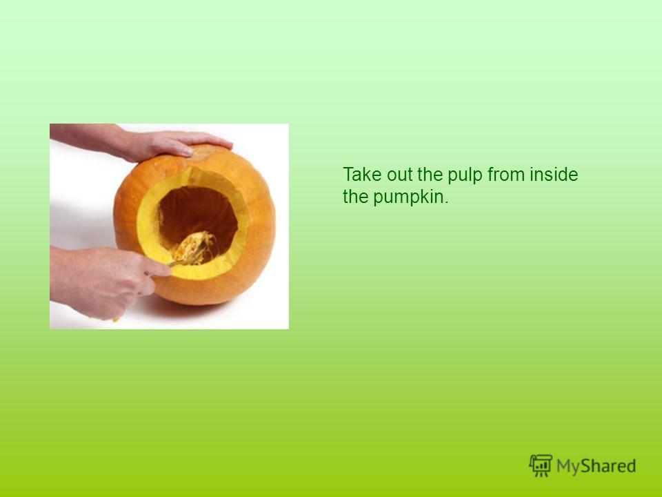 Take out the pulp from inside the pumpkin.