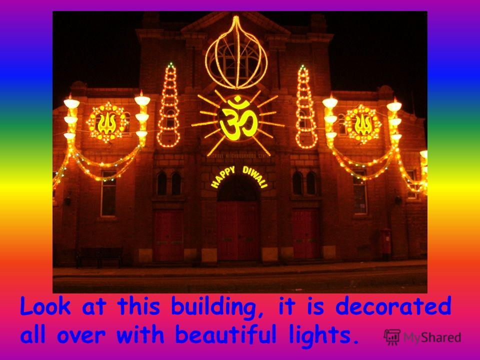 Look at this building, it is decorated all over with beautiful lights.